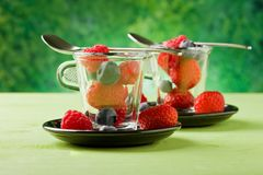 Berries inside a glass cup Royalty Free Stock Photo