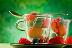 Berries inside a glass cup Stock Photos