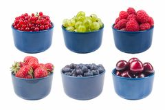 Berries on Isolated white background, bowl of Cherry, currant, blueberries, gooseberries, raspberries, blackberries. Various summer Fresh berries in a bowl Royalty Free Stock Photography