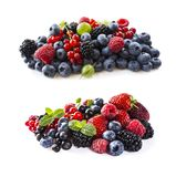 Berries isolated on white background. Ripe blueberries, blackberries, blackcurrants, raspberries, gooseberries, strawberries and r. Ed currants. Mix fruits on stock photo
