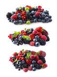 Berries isolated on white background. Ripe blueberries, blackberries, blackcurrants, raspberries, gooseberries, strawberries and r. Ed currants. Mix fruits on stock images