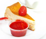 Berries, jam, cakes, pieces of a pie and other food on a white background Stock Image