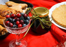 Berries and jam in a jar Royalty Free Stock Photo