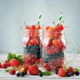 Berries in  jar with handle Stock Photos