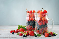 Berries in  jar with handle Stock Image