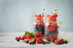 Berries in  jar with handle Royalty Free Stock Photos