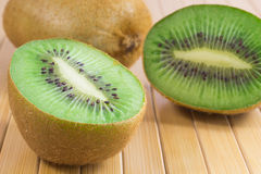 Berries kiwi. Two halves and whole Stock Photo