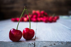 Berries of light cherry on a wooden background stock images