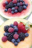 Berries and melon Stock Photos