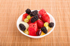 Berries Melons and Grapes in White Bowl Royalty Free Stock Image