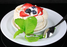 Berries on meringue nests Royalty Free Stock Photography