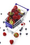 Berries in a mini shopping cart Stock Photography