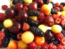 Berries mix. Cherry raspberry mulberry white cherry stock images