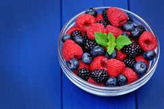 Berries mix blueberry, raspberry and blackberry in a bowl royalty free stock photos