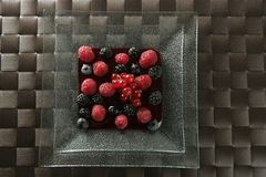 Berries mix dessert. Berries, mixed dessert with strwberry syrup stock photography