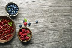 Berries fruits on wooden background royalty free stock photo