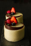 Berries mousse cake. Homemade berries mousse cake toping with strawberry , raspberry ,blueberry,chocolate Royalty Free Stock Image