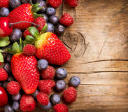 Berries over Wood Royalty Free Stock Photos