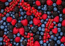 Berries overhead Background. Fresh Summer Berry mix with Strawberry, Raspberry, Red currant, Blueberry and Blackberry, top view.  royalty free stock images