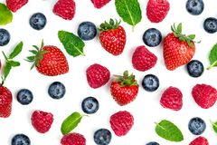 Berries Pattern. Fresh berries isolated on white background, top. View. Strawberry, Raspberry, Blueberry and Mint leaf, flat lay Royalty Free Stock Image