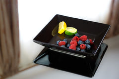 Berries. A plate of fresh berries stock image