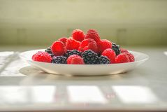 Berries on a plate. stock photos