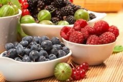Berries in plates Royalty Free Stock Image