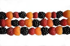 Berries raspberries black, yellow and green on a white royalty free stock photos