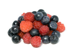 Berries of raspberry and bilberry. On white background Royalty Free Stock Image