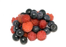 Berries of raspberry and bilberry. On white background Royalty Free Stock Photos