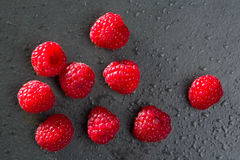 Berries raspberry on black slate background Stock Photography