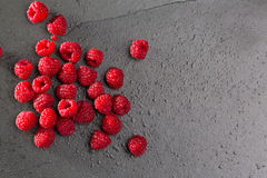 Berries raspberry on black slate background Stock Photos