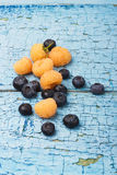 Berries of raspberry and blueberry on the wooden boards. Bunch of raspberry and blueberry on the wooden boards Stock Image