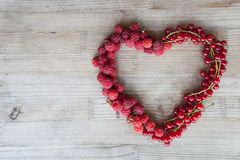 Berries - raspberry and currant. In the right of table. Close up image Royalty Free Stock Image