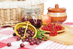 Berries of red currant and gooseberry on the table Stock Photo