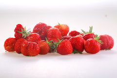 Berries of a red ripe strawberry on a white background. Fresh strawberry royalty free stock photography
