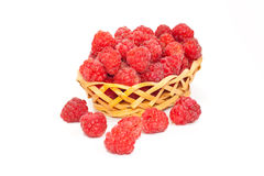 Berries of ripe raspberry in the wattled vase. Isolated on a white background Royalty Free Stock Photo