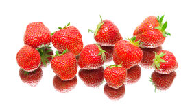 Berries of a ripe strawberry. white background - top view. Royalty Free Stock Photos