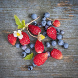 Berries on rustic wood background Royalty Free Stock Photos