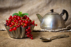 Berries in sackcloth. Red berries in a sack in a cupcake form stock images