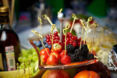 Berries on a skewer. Fruit snack during the holiday Stock Photo