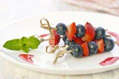 Berries on a skewers Royalty Free Stock Image
