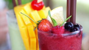Berries smoothies and mango tropical drink stock video