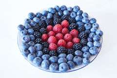 Berries. Some sort of berries: blueberries, blackberries, raspberries Stock Image