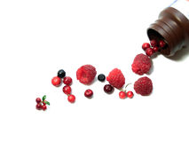 Berries spilling out of pills bottle Stock Images
