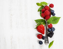 Berries with spoon  on Wooden Background. Health, Diet, Gardenin Royalty Free Stock Photography