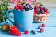 Berries spring fruits on blue wooden boards abstract still life. Closeup Royalty Free Stock Photography