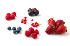 Berries and strawberries. In a white background stock photos