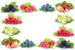 Berries strawberries blueberries red currant berry fruits frame Stock Photos