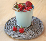 Berries of strawberry in a grey bucket Stock Images